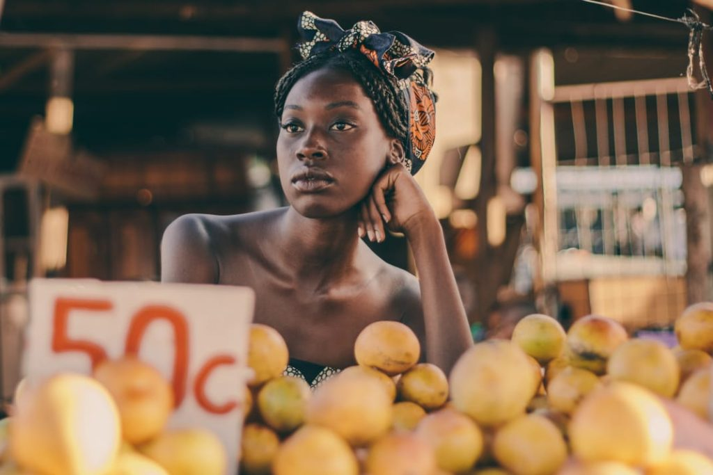 Tatenda WekwaTenzi waiting in a market in Cape Town